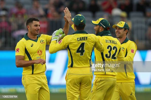 Marcus Stoinis of Australia celebrates the wicket of Aiden Markram of South Africa during game one of the One Day International series between...