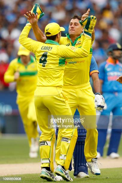 Marcus Stoinis of Australia celebrates the wicket of Shaker Dhawan of India during game three of the One Day International series between Australia...
