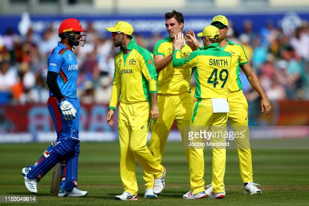 Marcus Stoinis of Australia celebrates with his teammates after dismissing Najibullah Zadran of Afghanistan during the Group Stage match of the ICC...