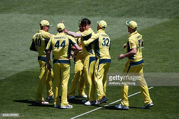 Marcus Stoinis of Australia celebrates with teammates for the wicket of Colin Munro of New Zealand during the first One Day International game...