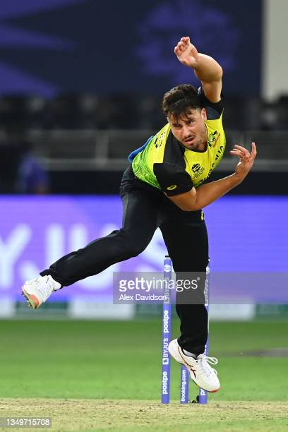 Marcus Stoinis of Australia in bowling action during the ICC Men's T20 World Cup match between Australia and Sri Lanka at Dubai International Stadium...