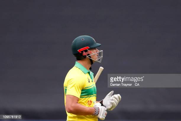 Marcus Stoinis of Australia walks from the field after being dismissed during game three of the One Day International series between Australia and...