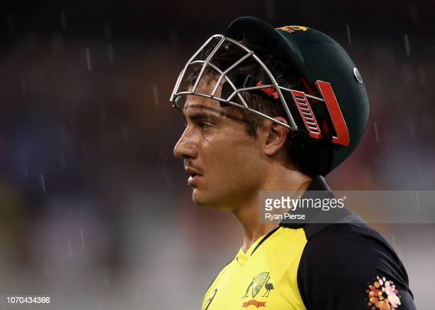 Marcus Stoinis of Australia walks from the ground during a rain delay during game one of the the International Twenty20 series between Australia and...