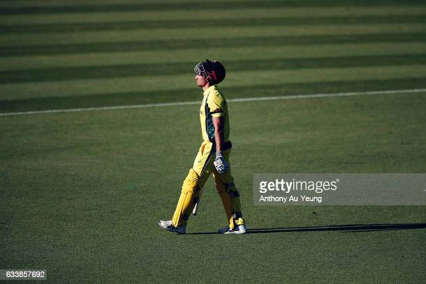 Marcus Stoinis of Australia walks off the field after being dismissed by Mitchell Santner of New Zealand during game three of the One Day...