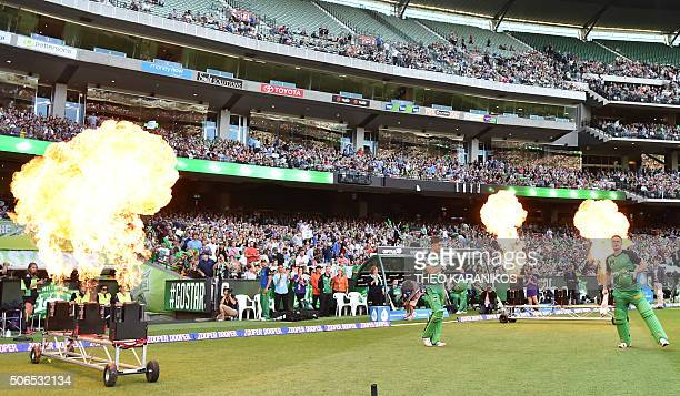 Marcus Stoinis of the Melbourne Stars and teammate Luke Wright enter the arena before the start of the T20 Big Bash League cricket final between the...