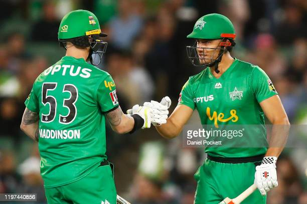 Marcus Stoinis of the Stars and Nic Maddinson of the Stars touch gloves during the Big Bash League match between the Melbourne Stars and the...