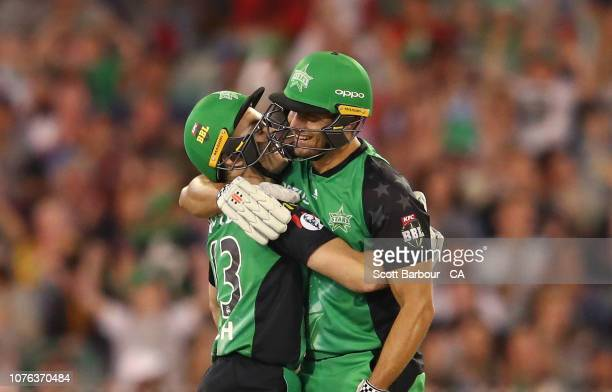 Marcus Stoinis of the Stars is congratulated by Seb Gotch after hitting the winning runs during the Big Bash League match between the Melbourne Stars...