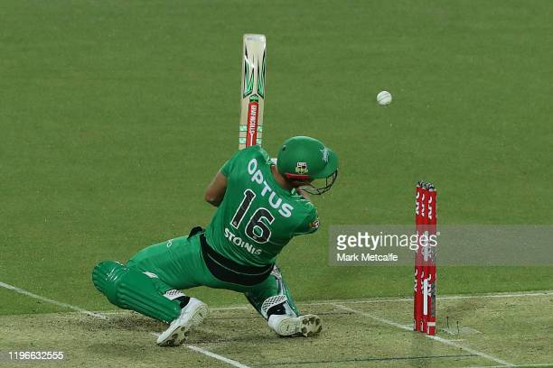 Marcus Stoinis of the Stars is struck on the helmet by a delivery from Riley Meredith of the Hurricanes during the Big Bash League match between the...