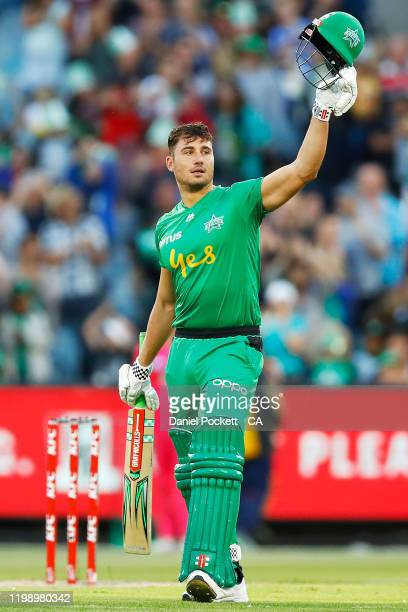 Marcus Stoinis of the Stars raises his bat after making one hundred runs during the Big Bash League match between the Melbourne Stars and the Sydney...