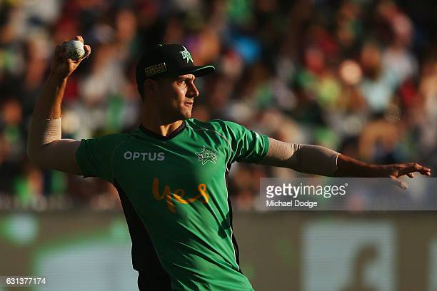 Marcus Stoinis of the Stars throws the ball in the warm up during the Big Bash League match between the Melbourne Stars and the Adelaide Strikers at...
