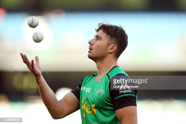 Marcus Stoinis of the Stars warms up prior to the Big Bash League match between the Melbourne Stars and the Sydney Sixers at the Melbourne Cricket...