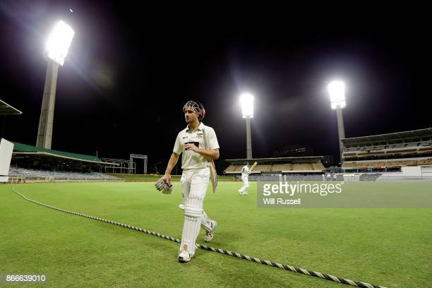 Marcus Stoinis of the Warriors walks back to the rooms after being dismissed by Jake Doran of the Tigers during day one of the Sheffield Shield match...