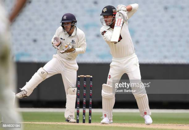 Marcus Stoinis of Western Australia bats as wicketkeeper Seb Gotch of Victoria looks on during day one of the Sheffield Shield match between Victoria...