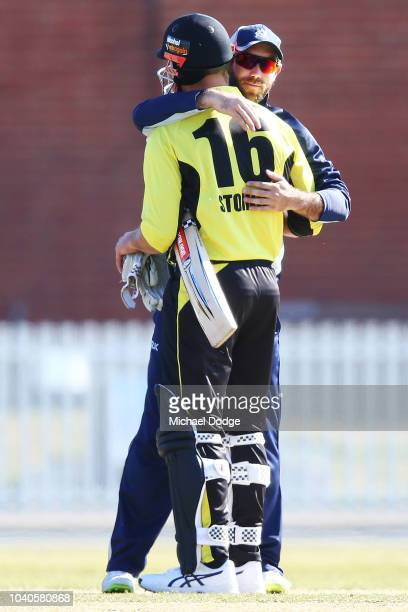 Marcus Stoinis of Western Australia is hugged by former teammate Glenn Maxwell of Victoria after he hits the winning runs during the JLT One Day Cup...