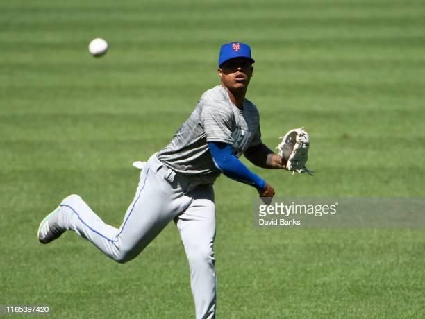 Marcus Stroman new pitcher of the New York Mets warms up in the outfield before a game against the Chicago White Sox at Guaranteed Rate Field on July...