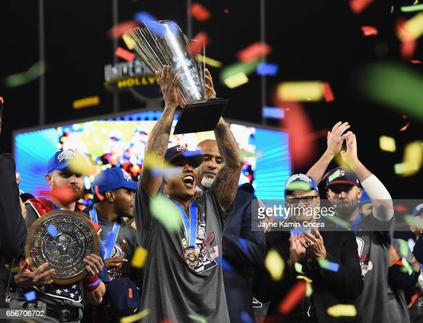 Marcus Stroman of team United States celebrates with the trophy after their 80 win over team Puerto Rico during Game 3 of the Championship Round of...