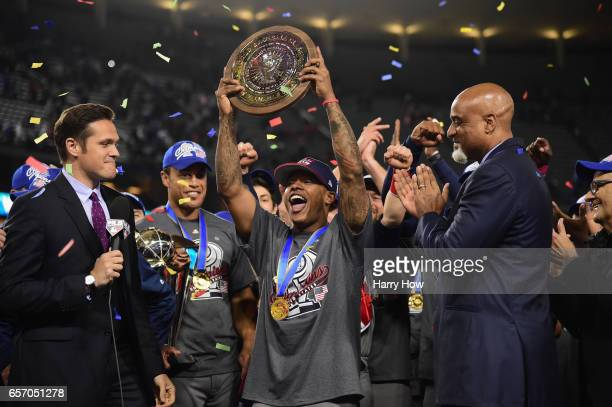 Marcus Stroman of team United States is awarded with the MVP trophy after their 80 win over team Puerto Rico during Game 3 of the Championship Round...