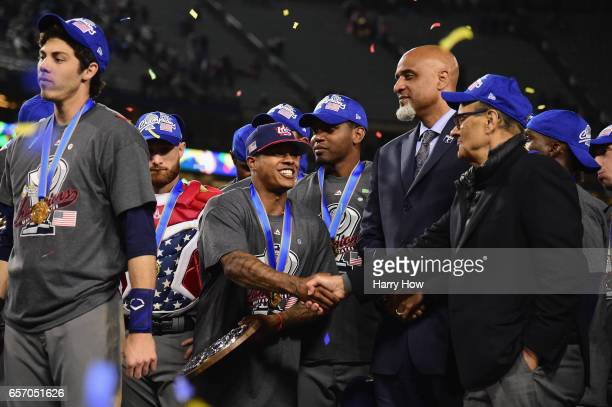Marcus Stroman of team United States is congratulated by Joe Torre after being awarded with the MVP trophy after their 80 win over team Puerto Rico...