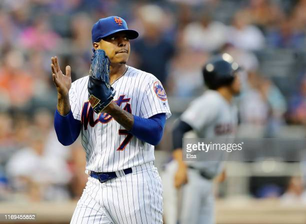Marcus Stroman of the New York Mets celebrates after Juan Lagares made the catch for the out to end the first inning against the Cleveland Indians at...