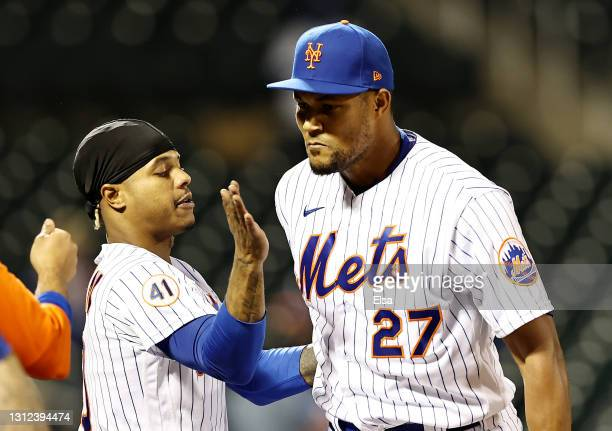 Marcus Stroman of the New York Mets congratulates Jeurys Familia on the save after the game against the Philadelphia Phillies during game two of a...