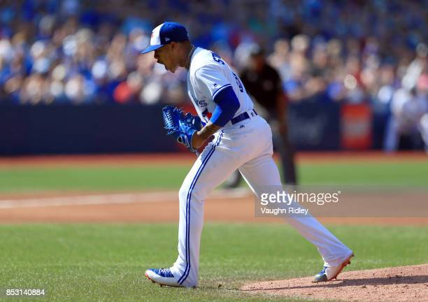 Marcus Stroman of the Toronto Blue Jays celebrates after striking out the side in the fourth inning during MLB game action against the New York...