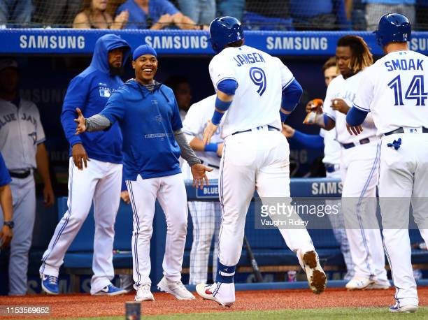 Marcus Stroman of the Toronto Blue Jays congratulates Danny Jansen after he hit a two run home run in the fourth inning during a MLB game against the...
