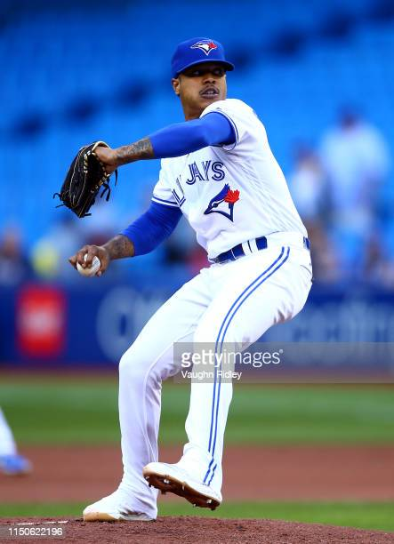 Marcus Stroman of the Toronto Blue Jays delivers a pitch in the first inning during a MLB game against the Los Angeles Angels of Anaheim at Rogers...