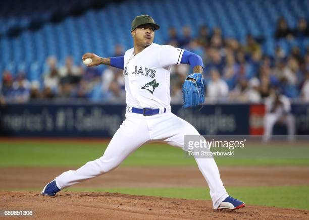 Marcus Stroman of the Toronto Blue Jays delivers a pitch in the first inning during MLB game action against the Cincinnati Reds at Rogers Centre on...