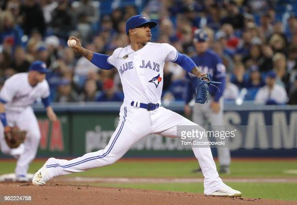 Marcus Stroman of the Toronto Blue Jays delivers a pitch in the first inning during MLB game action against the Texas Rangers at Rogers Centre on...