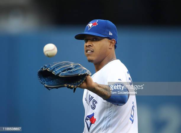 Marcus Stroman of the Toronto Blue Jays gets the baseball as he gets ready to pitch in the first inning during MLB game action against the Arizona...