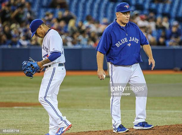 Marcus Stroman of the Toronto Blue Jays heads for the dugout after handing over the ball to Jays manager John Gibbons during the game between the...