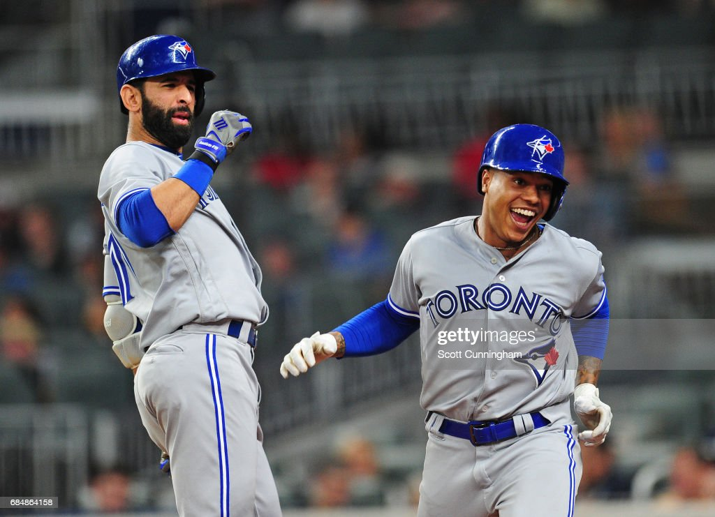 Marcus Stroman #6 (R) of the Toronto Blue Jays is congratulated by Jose Bautista #19 after hitting a fourth inning solo home run against the Atlanta Braves at SunTrust Park on May 18, 2017 in Atlanta, Georgia.