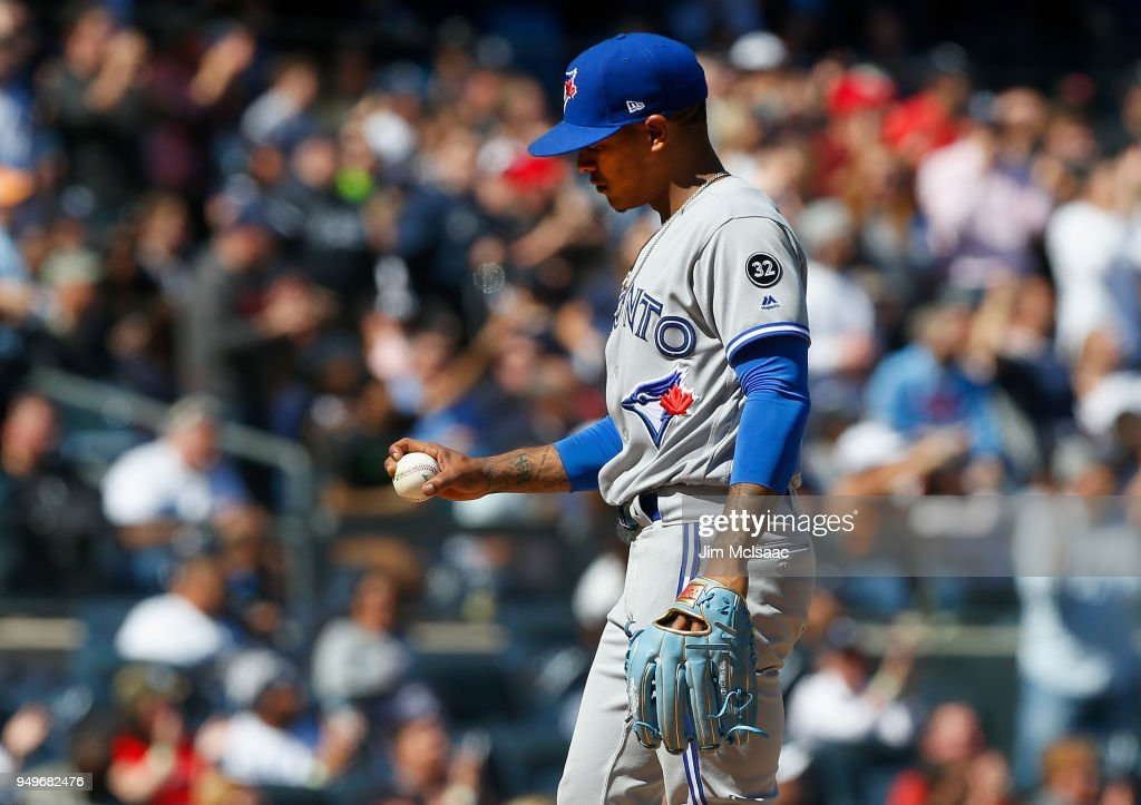 Marcus Stroman #6 of the Toronto Blue Jays looks at the ball as he stands on the mound during the sixth inning against the New York Yankees at Yankee Stadium on April 21, 2018 in the Bronx borough of New York City.