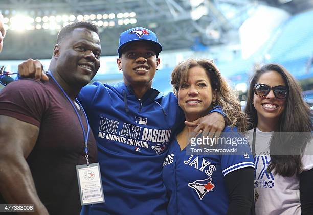 Marcus Stroman of the Toronto Blue Jays poses with his parents and sister on Marcus Stroman Bobblehead Day before the start of MLB game action...