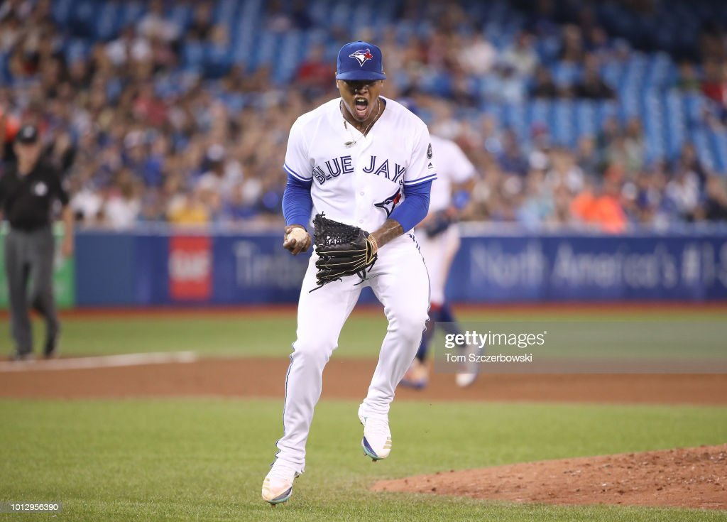 Marcus Stroman #6 of the Toronto Blue Jays reacts after fielding a grounder before making the play for the last out of the seventh inning during MLB game action against the Boston Red Sox at Rogers Centre on August 7, 2018 in Toronto, Canada.