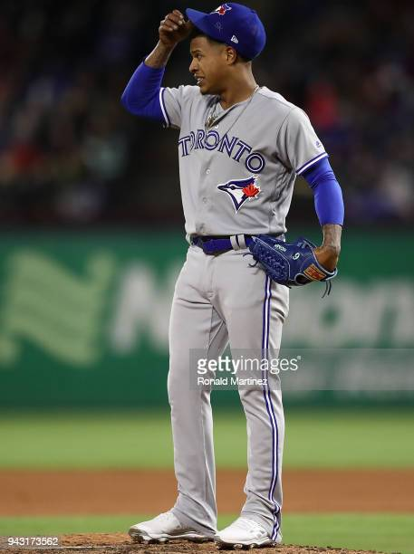 Marcus Stroman of the Toronto Blue Jays reacts after giving up a two run double against Joey Gallo of the Texas Rangers in the fifth inning at Globe...