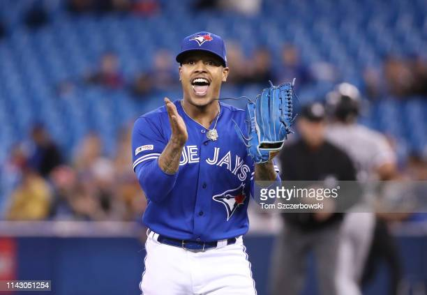 Marcus Stroman of the Toronto Blue Jays reacts after three quality defensive plays were made behind him in the field to end the first inning during...