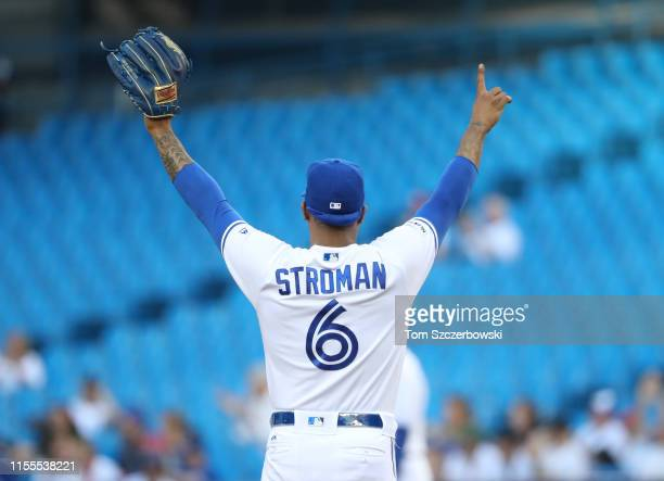 Marcus Stroman of the Toronto Blue Jays reacts to a sliding catch made by Randal Grichuk in right field in the first inning during MLB game action...