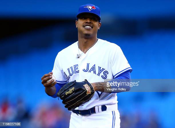 Marcus Stroman of the Toronto Blue Jays smiles in the direction of the dugout in the first inning during a MLB game against the Los Angeles Angels of...