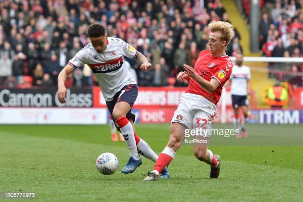 Marcus Tavernier and George Lapslie in action during the Sky Bet Championship match between Charlton Athletic and Middlesbrough at The Valley London...