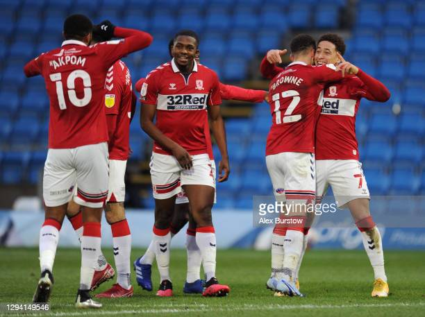 Marcus Tavernier of Middlesborough celebrates with Marcus Browne and teammates after scoring their team's second goal during the Sky Bet Championship...