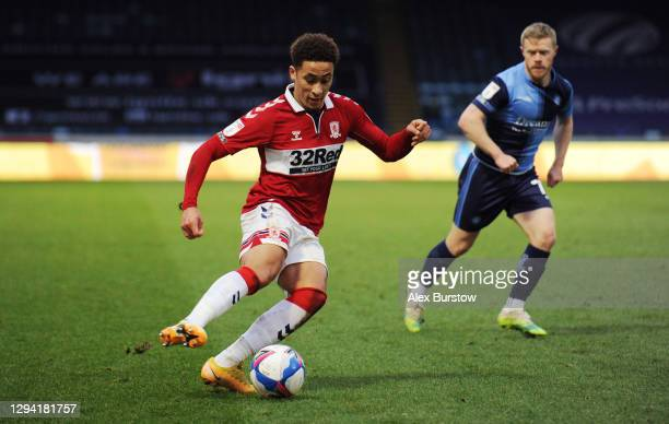 Marcus Tavernier of Middlesborough turns with the ball under pressure from Daryl Horgan of Wycombe Wanderers during the Sky Bet Championship match...