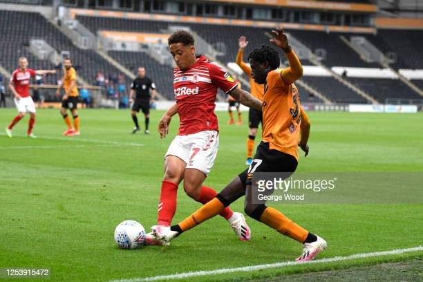 Marcus Tavernier of Middlesbrough battles for possession with Leonardo Da Silva Lopes of Hull City during the Sky Bet Championship match between Hull...