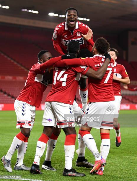 Marcus Tavernier of Middlesbrough celebrates with Marc Bola and team mates after scoring their side's second goal during the Sky Bet Championship...