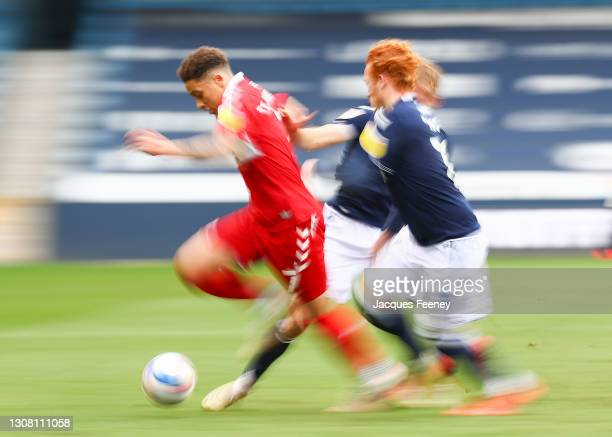 Marcus Tavernier of Middlesbrough is put under pressure by Billy Mitchell of Millwall and Ryan Woods of Millwall during the Sky Bet Championship...
