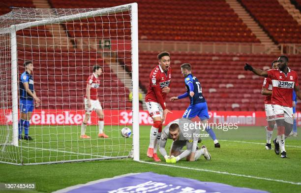 Marcus Tavernier of Middlesbrough runs past goalkeeper Daniel Iverson after scoring the second Boro goal during the Sky Bet Championship match...