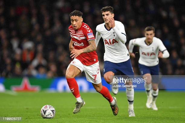 Marcus Tavernier of Middlesbrough takes on Erik Lamela of Tottenham Hotspur during the FA Cup Third Round Replay match between Tottenham Hotspur and...
