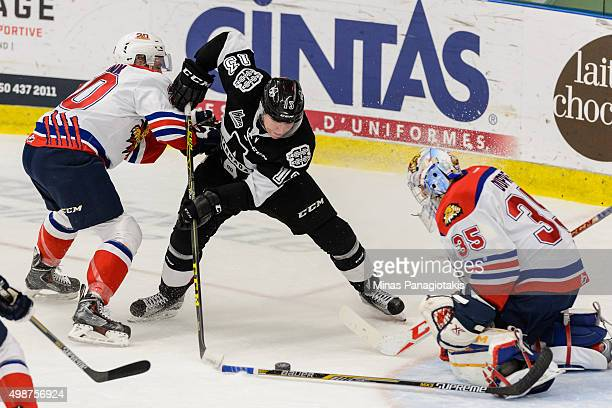 Marcus Tesink of the Moncton Wildcats defends against Connor Bramwell of the Blainville-Boisbriand Armada during the QMJHL game at the Centre...
