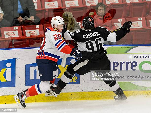 Marcus Tesink of the Moncton Wildcats sidesteps a hit by Kristian Pospisil of the Blainville-Boisbriand Armada during the QMJHL game at the Centre...