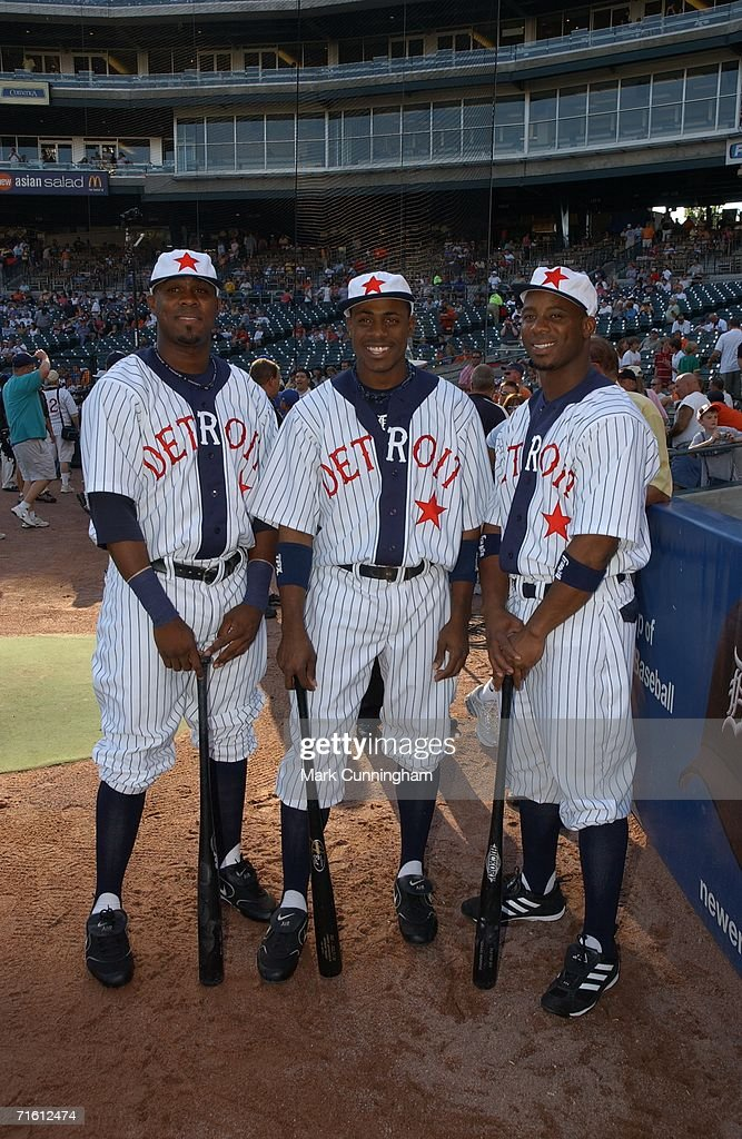 Marcus Thames, Curtis Granderson and Craig Monroe of the Detroit Tigers pose in their Detroit Stars Negro League uniforms prior to the game against the Kansas City Royals at Comerica Park in Detroit, Michigan on July 15, 2006. The Tigers defeated the Royals, 6-0.